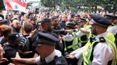 Police Fight With Angry Anti-Vax Demonstrators Near To The MHRA Headquarters In Canary Wharf London