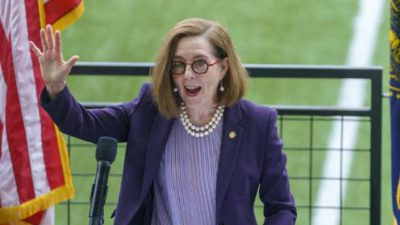 Police and Firefighters Sue Oregon Governor Kate Brown Over Vaccination Mandate